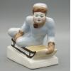 Фарфоровая статуэтка Мальчик на санках